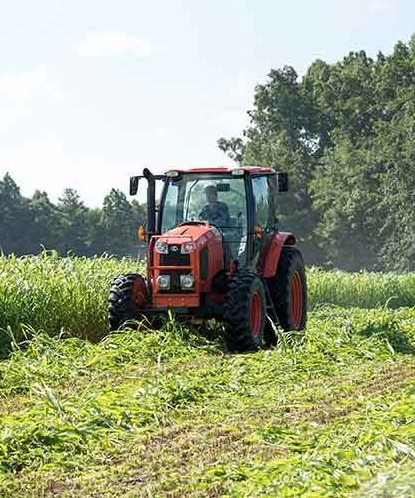 farm field with tractor