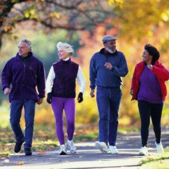 Elderly group of people walking on a trial