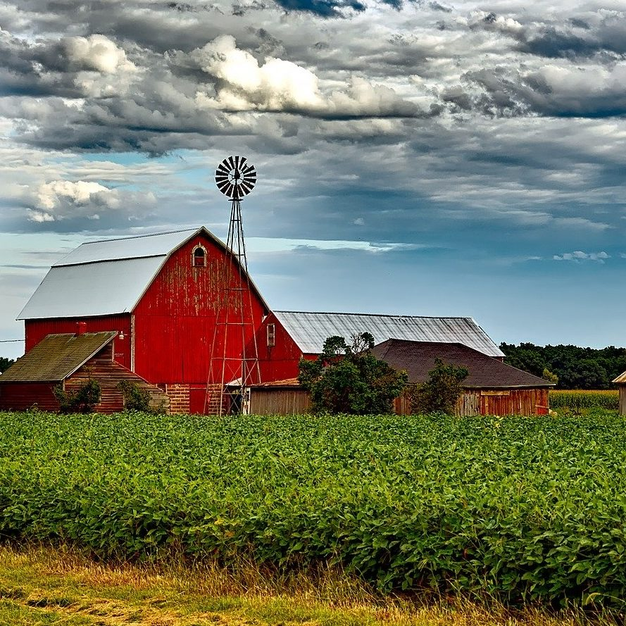 Red barn with gray clouds in background